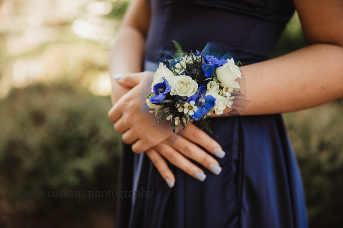 detail image of a young woman wearing a corsage
