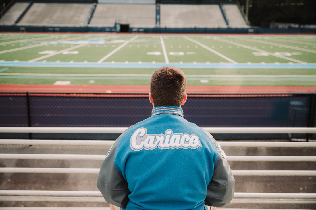 portrait of a teenagers varsity jacket from behind
