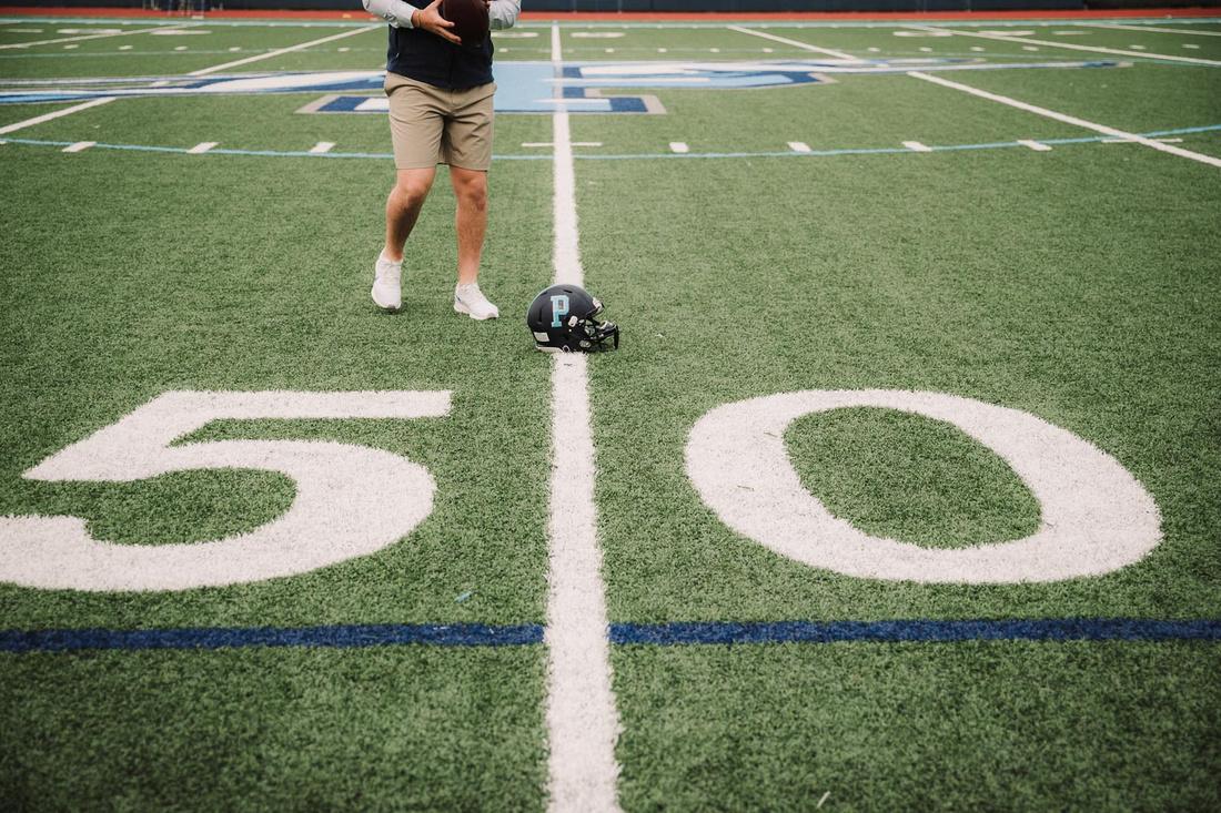 Seniors football helmet on the 50 yard line at pope high school by monica carlson