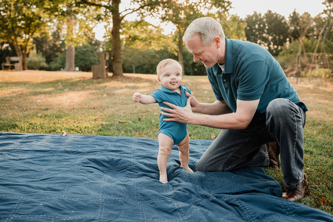 daddy holding his infant son up at Barrington Hall