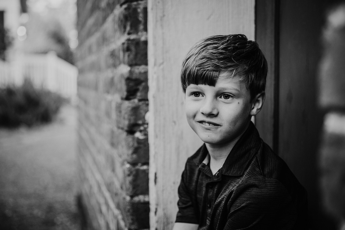 Black and white image of a boy in deep thought by monica carlson