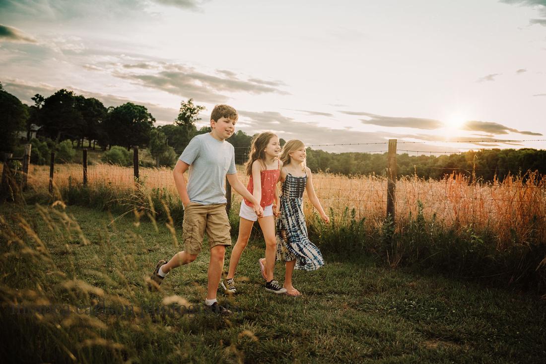 portrait of three kids walking on Prosepct farms by monica carlson photography