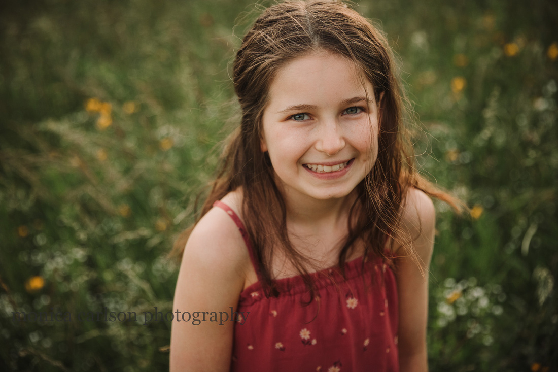 girl laughs while standing on a wildflower field at Prospect Farms