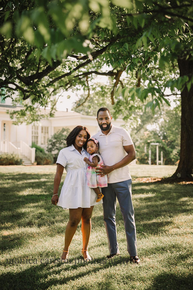 african american family of three in front of Barrington hall in roswell, ga