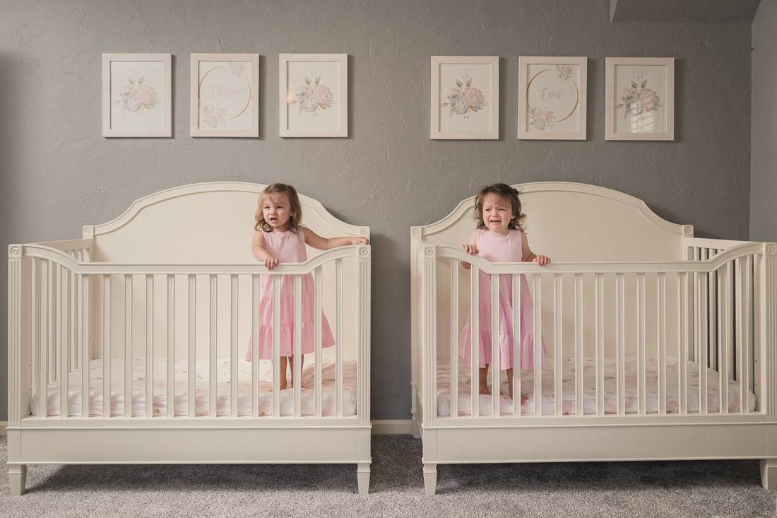 twin girls cry from their cribs