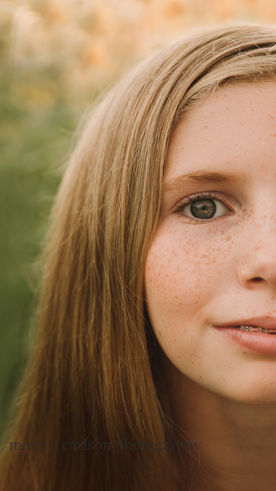 upclose image of a red headed freckled face girl