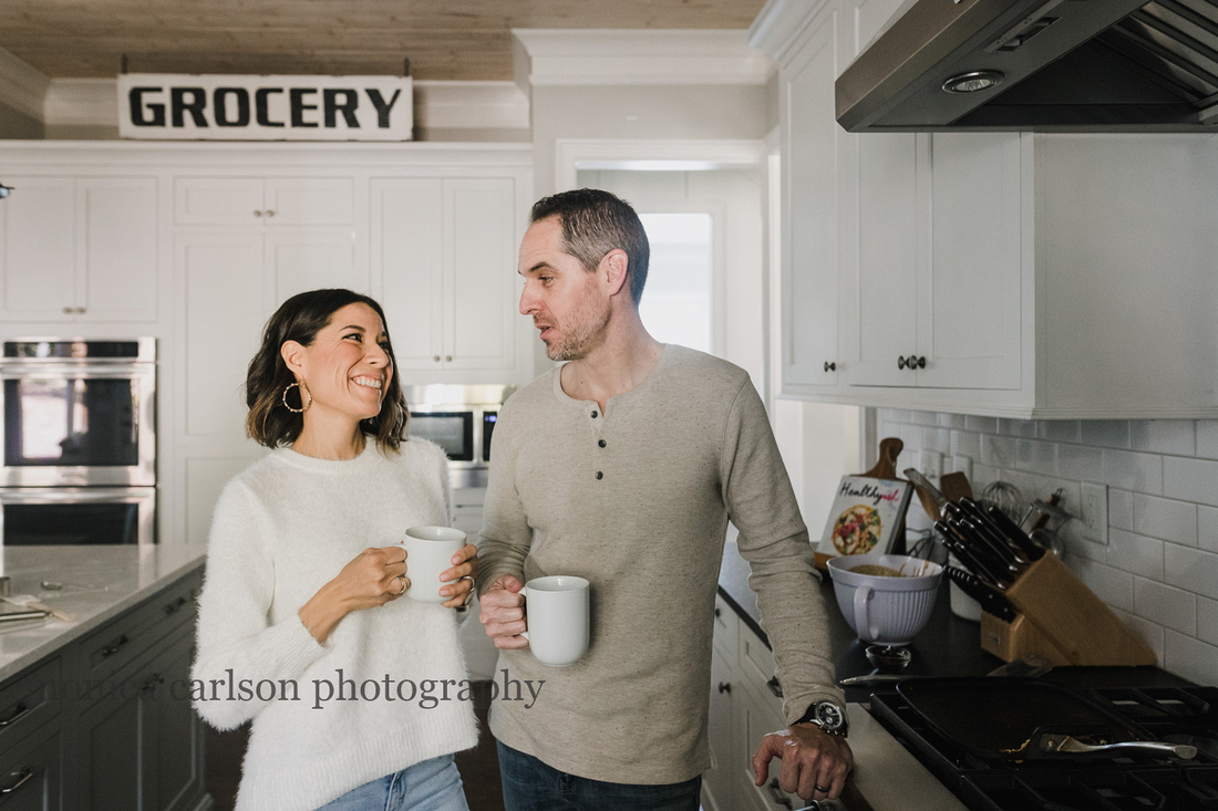 husband and wife drinking coffee in their kitchen during a family photo session