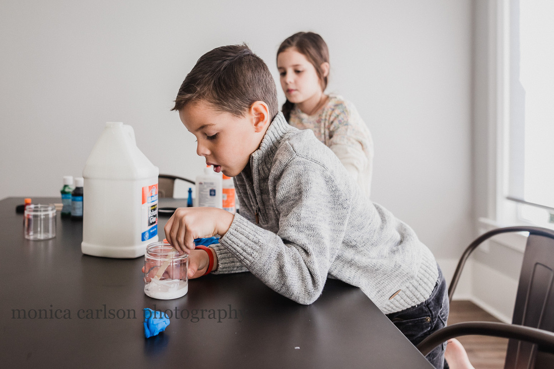 boy making slime during a photo session with monica carlson photography