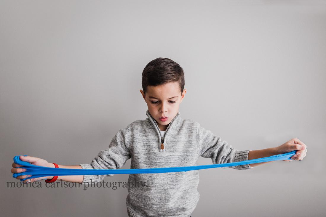 boy stretching his slime