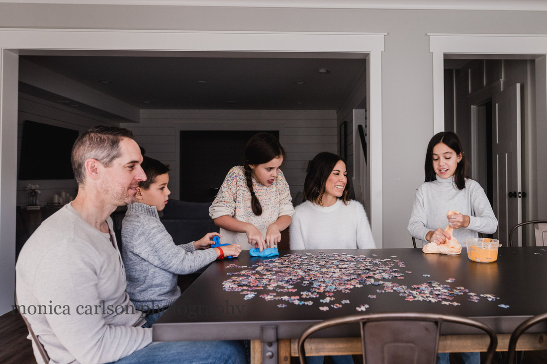 family bonding over slime and puzzles during a photo session with monica carlson