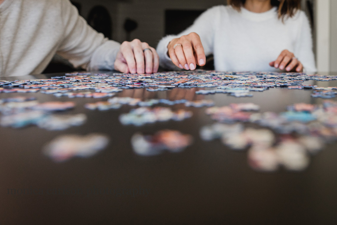 father and daughter making puzzles