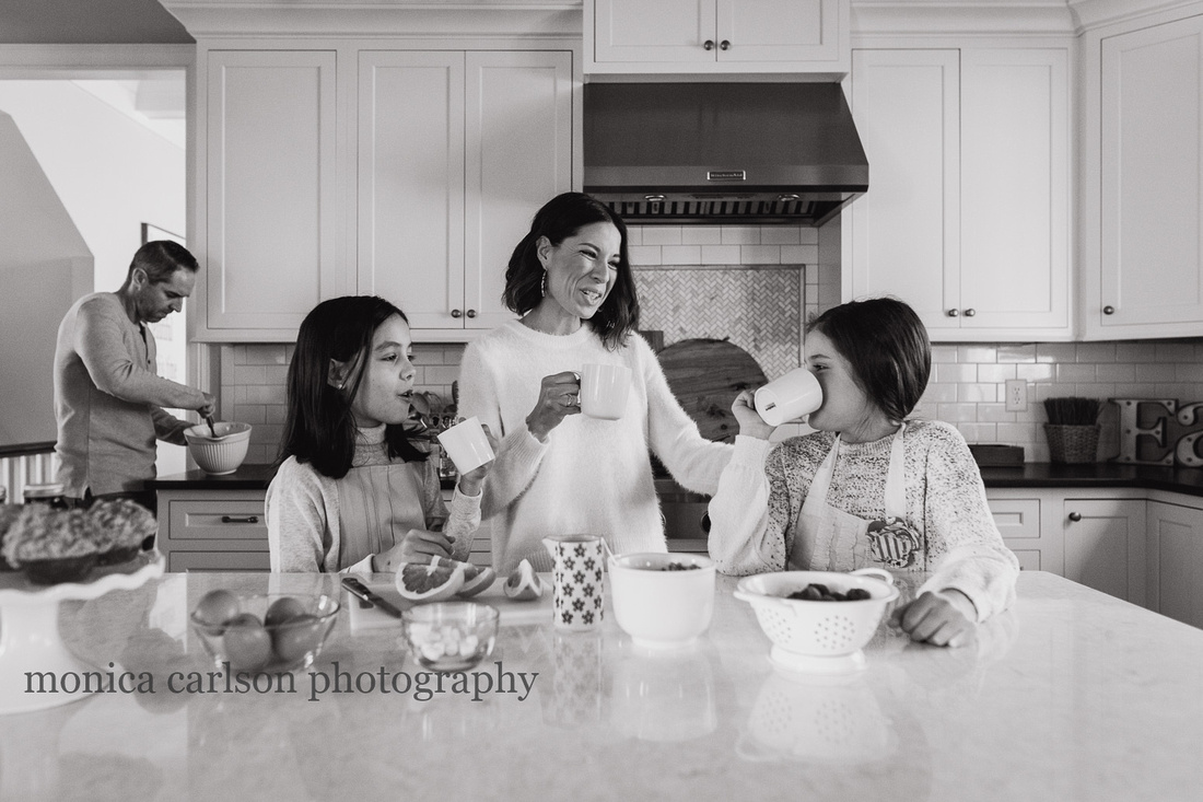 mother bonding with her daughters in the kitchen