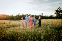 family walking on a wild flower field by monica carlson photography