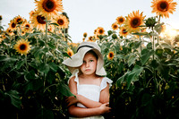 unhappy young girl on a sunflower field