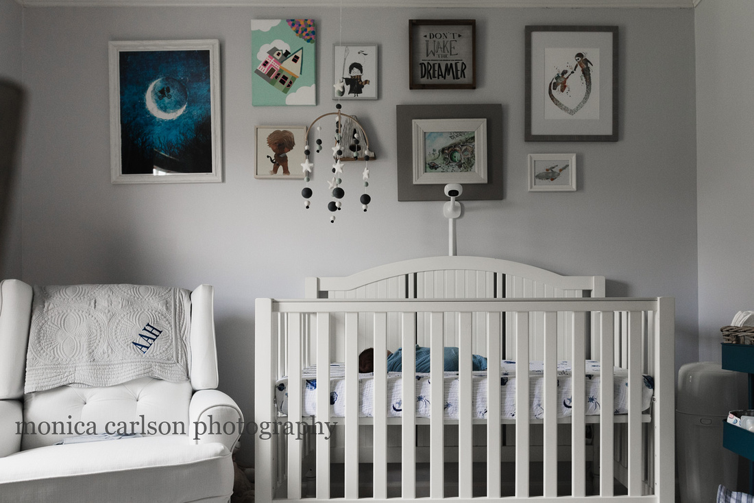 wide angle shot of a baby sleeping in his crib during a family photo session