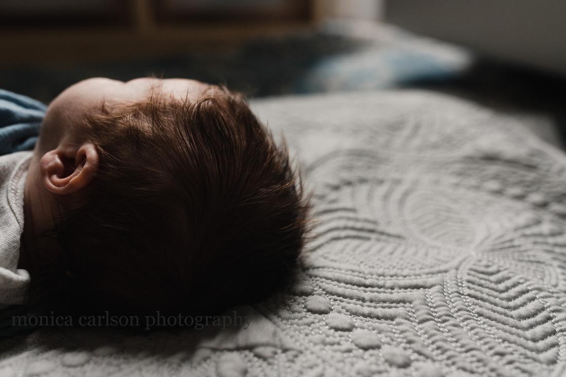 Newborn baby with a head full on dark hair