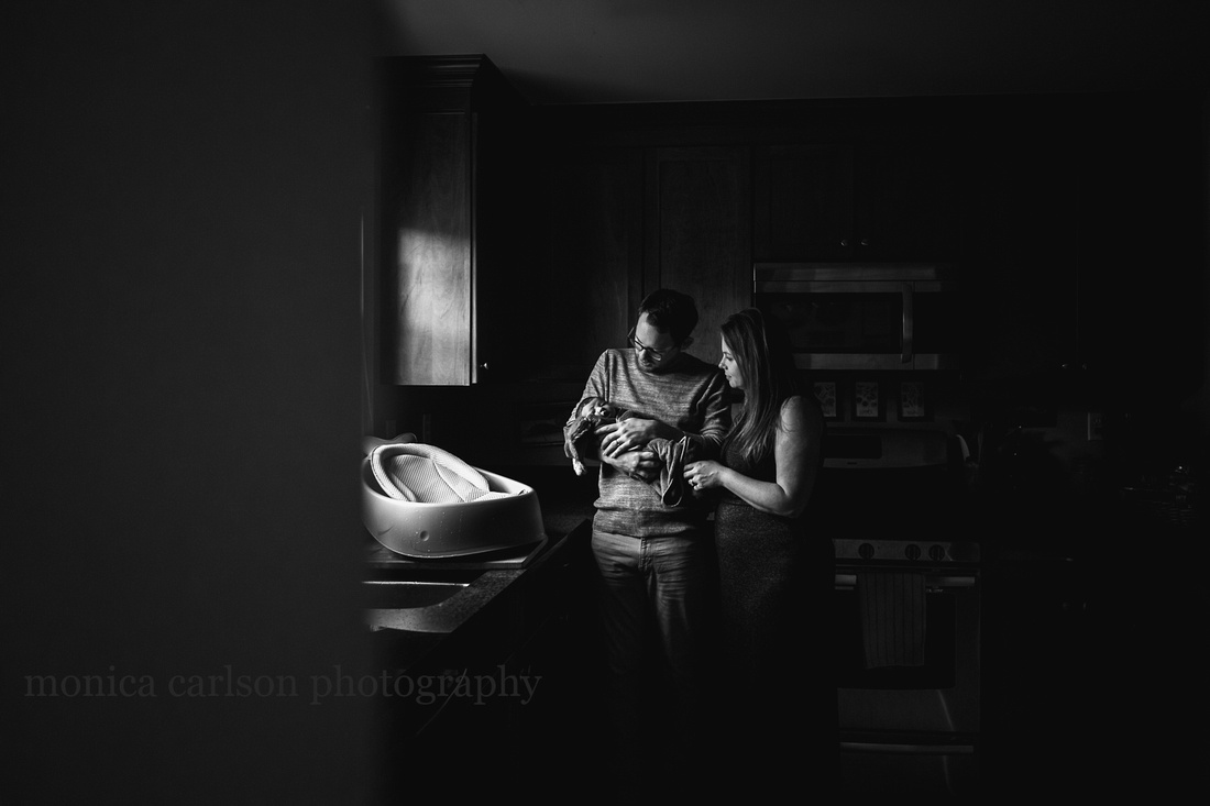 parents drying their son after a bath during a home session by monica carlson