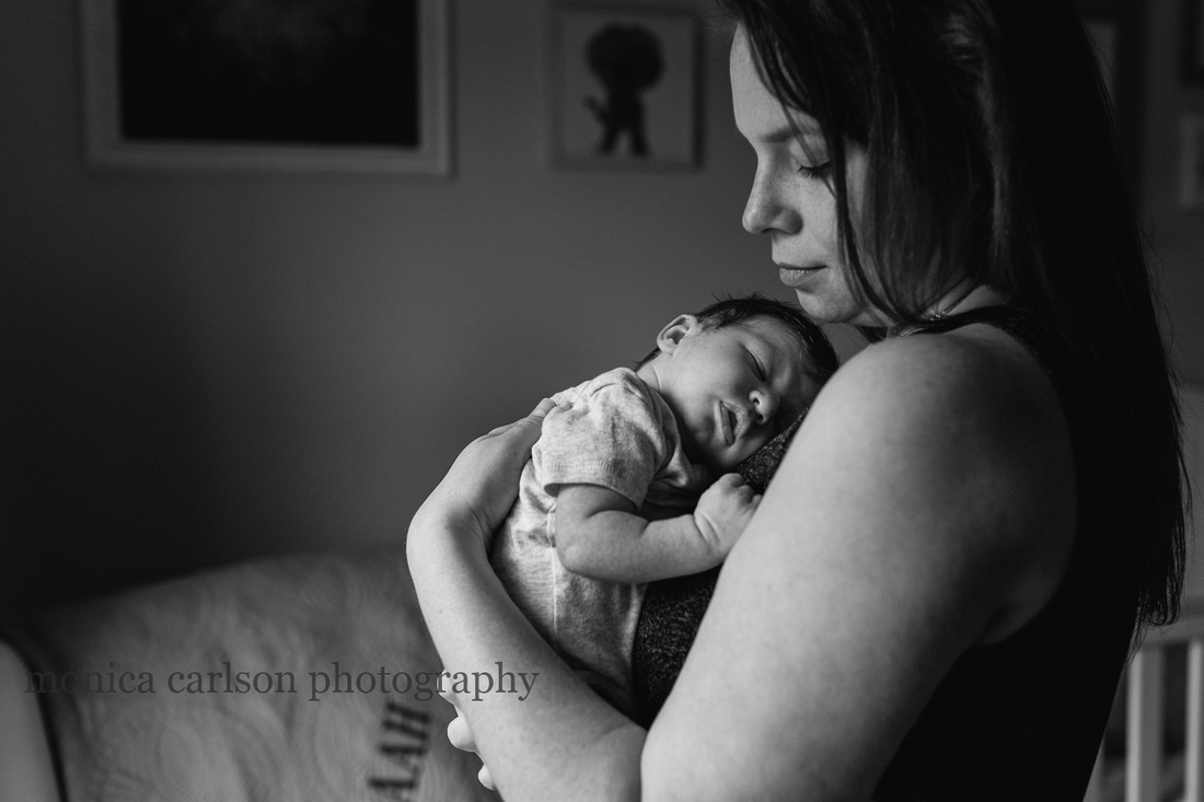 dramatic portrait of a mother holding her baby boy by monica carlson photography