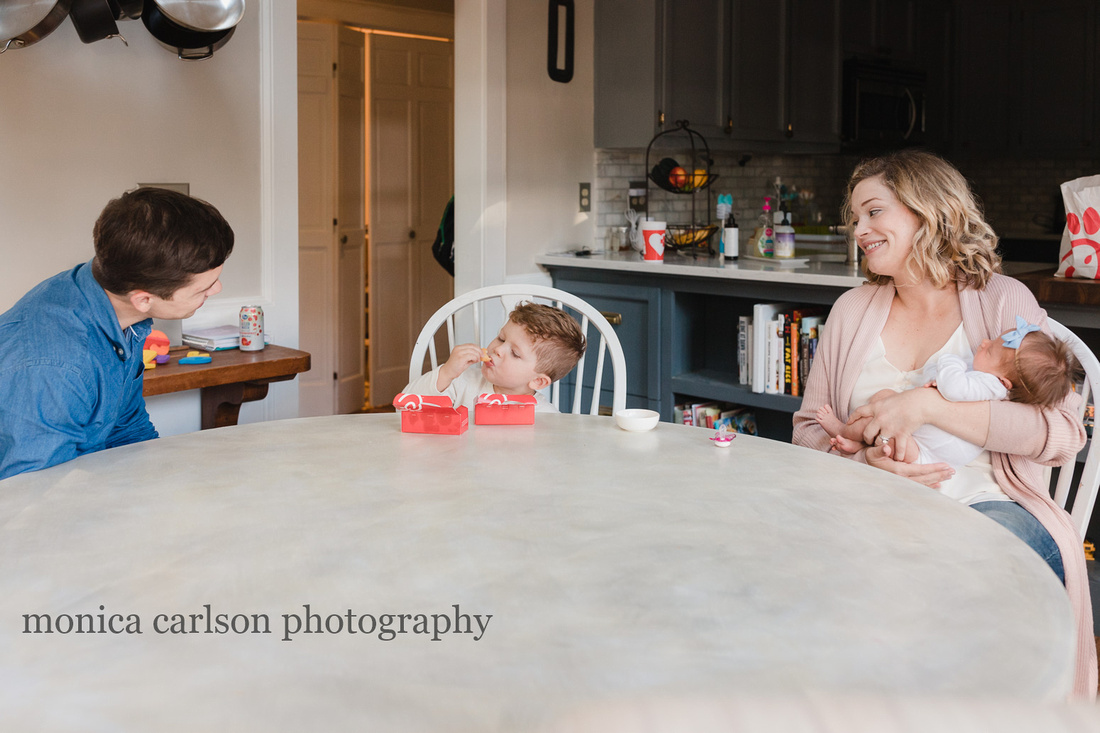 Family enjoying chick fil a in their home
