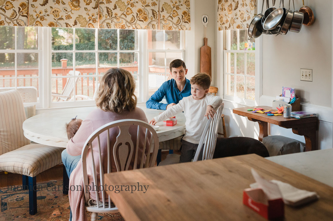 Family sitting around a table in their kitchen