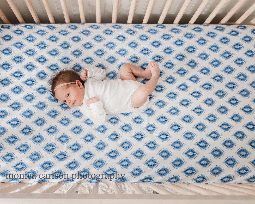 newborn laying in her crib in alpharetta, ga