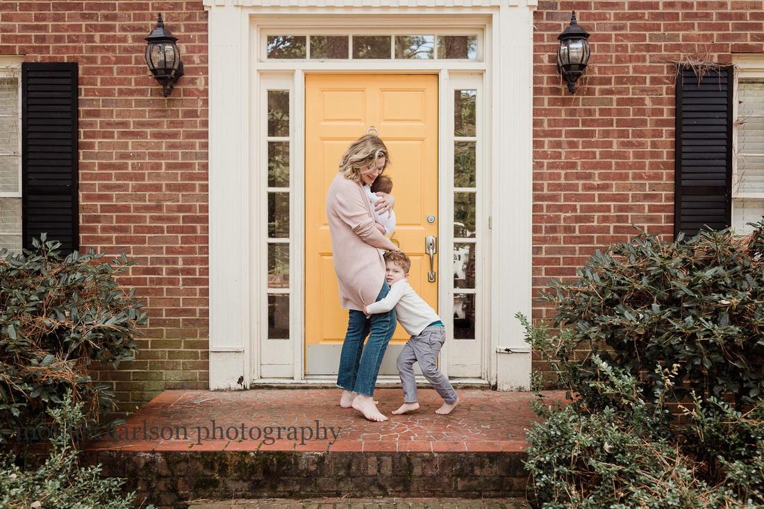 mom with her two children by her front door in Alpharetta