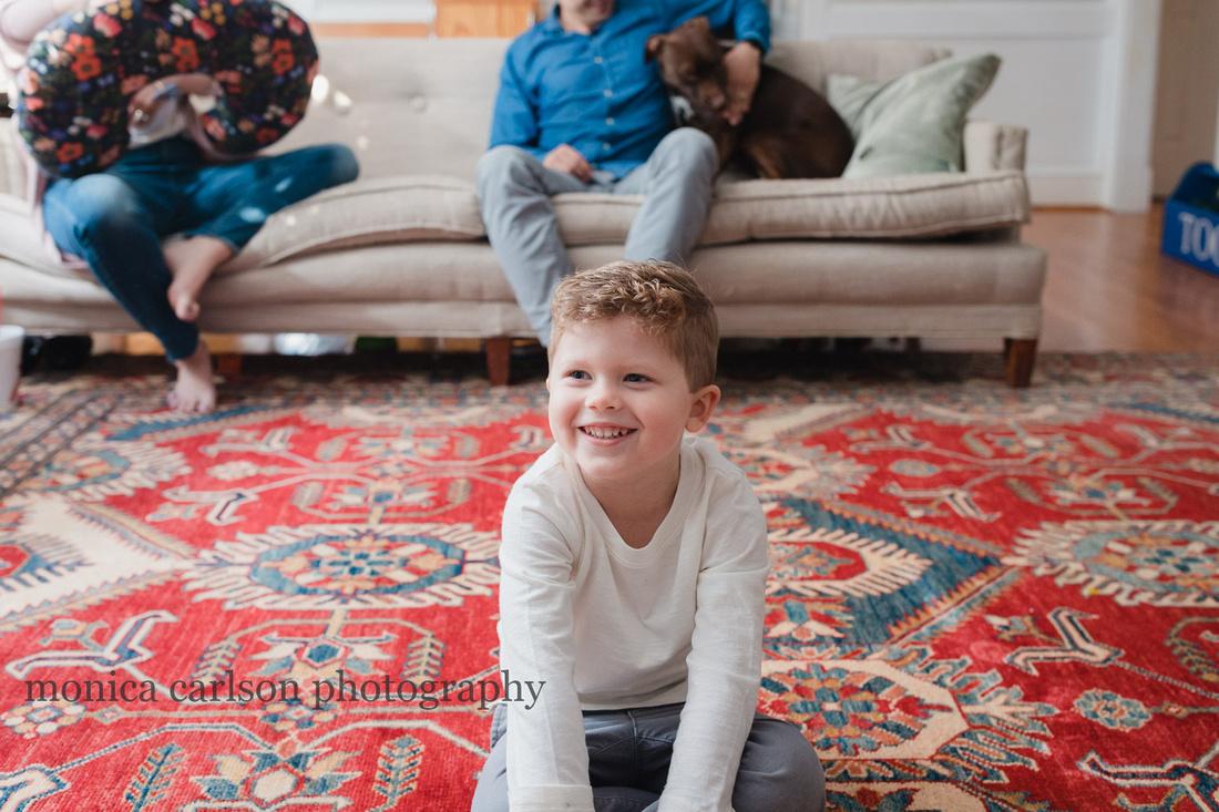boy sitting on the floor of his living in Alpharetta