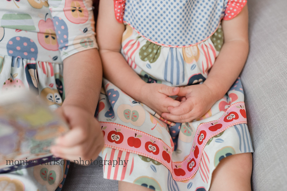 Detail photo of a small girls hands clasped together