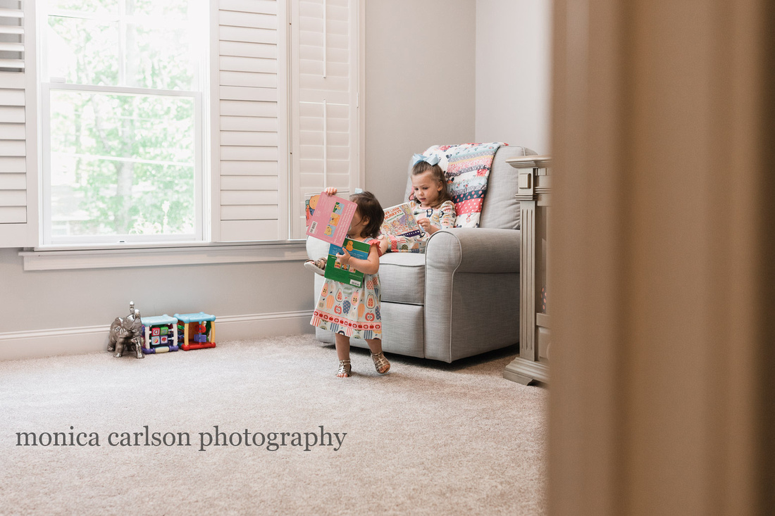 sisters playing at home during a family photo session with Monica carlson