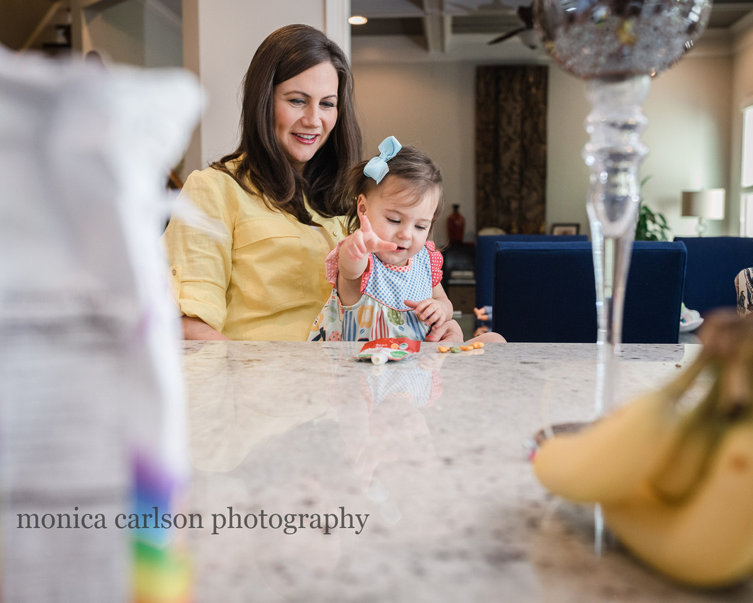 mother and daughter having a snack during a photo session at their home in alpharetta