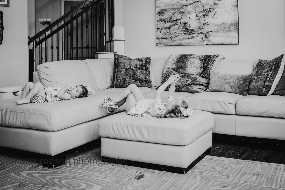 little girls resting on a couch in their living room