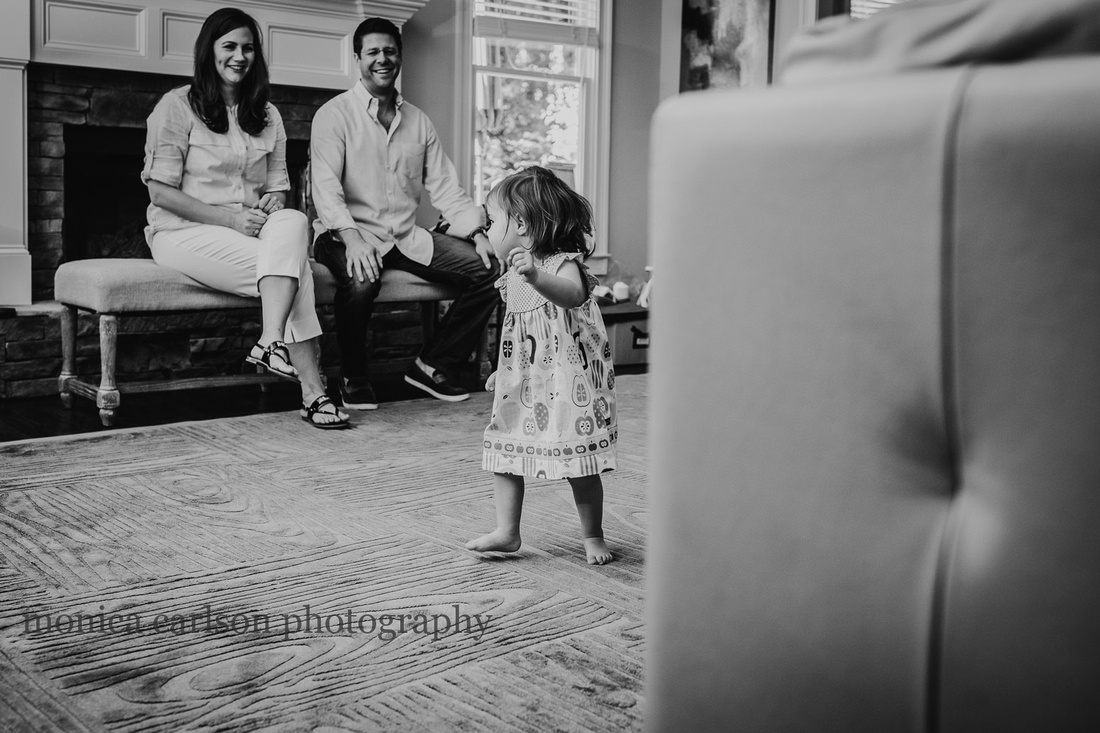 Parents watching their daughter dance in their living room in Alpharetta, GA