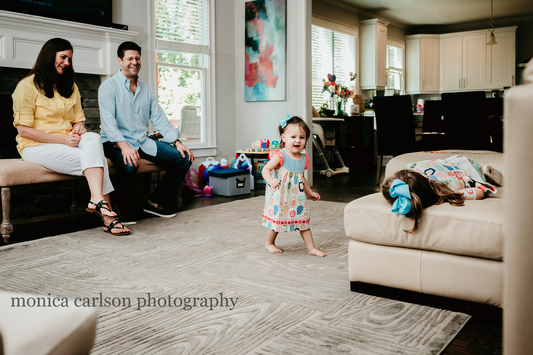 family watching their girls dance during a family photo session