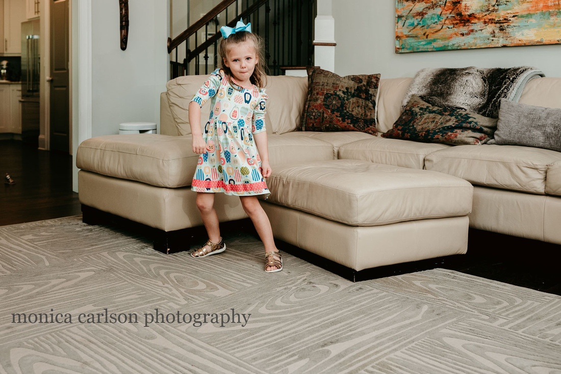 young girl dancing at home during a lifestyle session