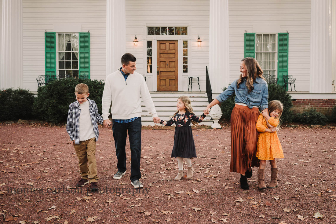 portrait of a family walking together in Roswell, GA