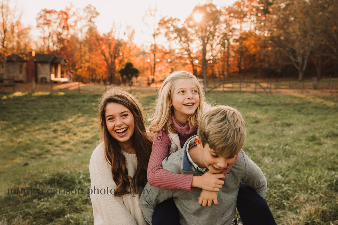 siblings enjoy a laugh during a family session with monica carlson