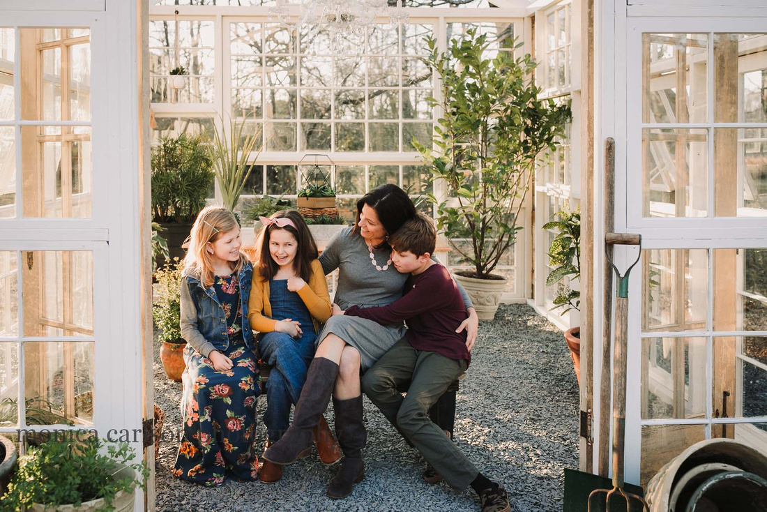 Mother and her children talking in a greenhouse in duluth, GA