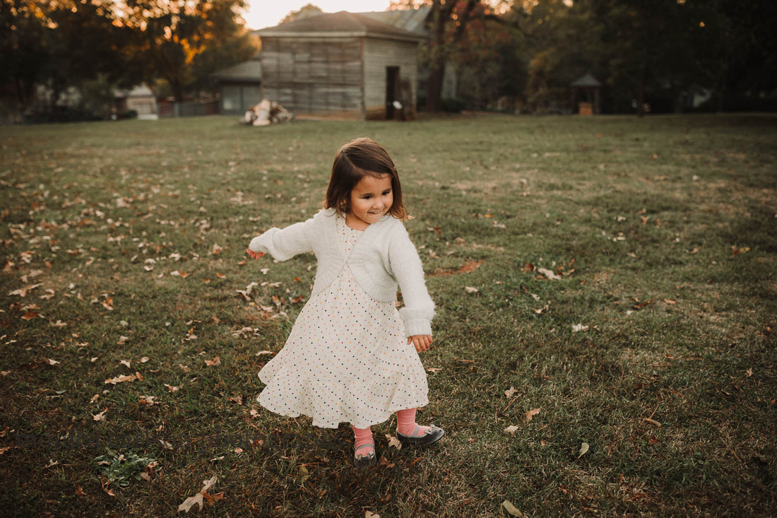 sweet little girl dancing during a session with monica carlson photography