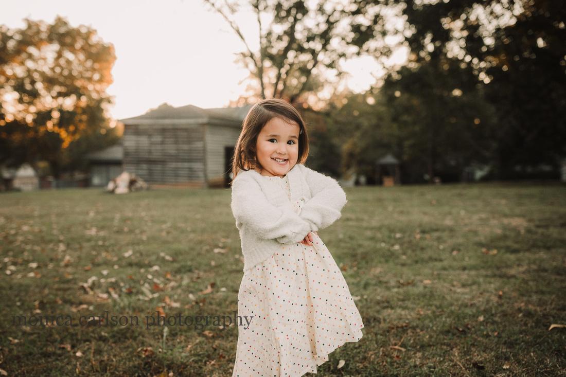 happy little girl with golden light surrounding her