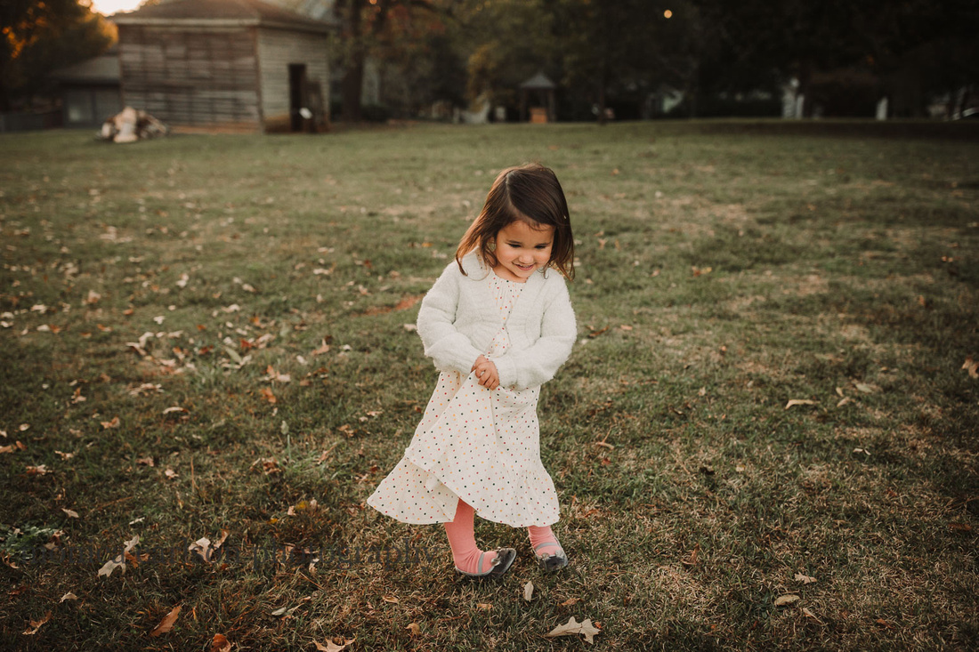 little girl clasping her hands while she dances at Barrington Hall