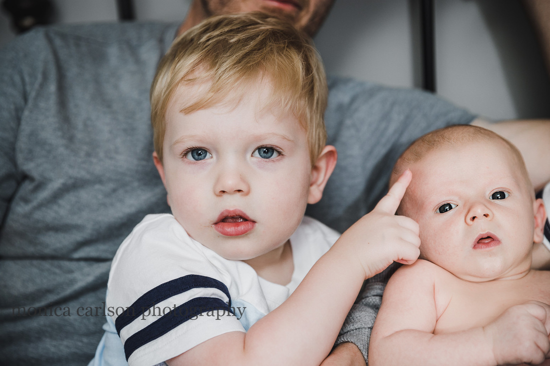 portrait of a toddler and newborn brother