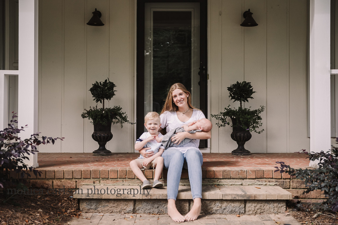 teenager with her toddler and newborn brothers, sitting on a porch