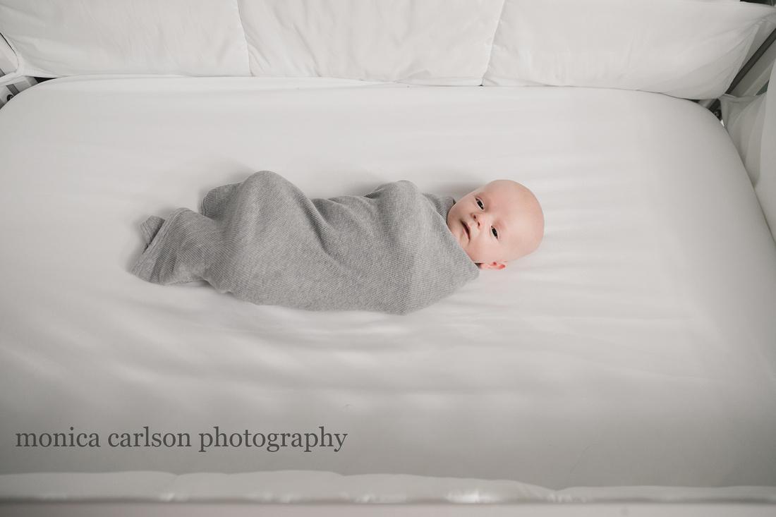 newborn baby in his crib