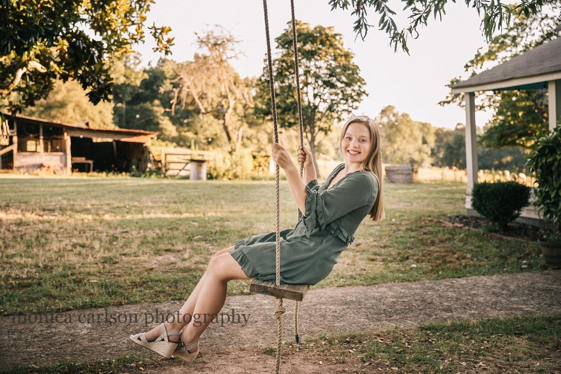high school senior on a swing