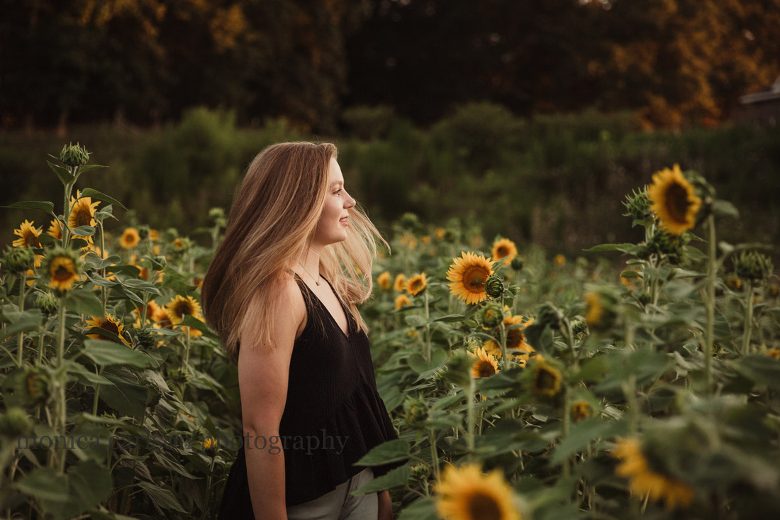 beautiful image of a young woman on a sunflower field