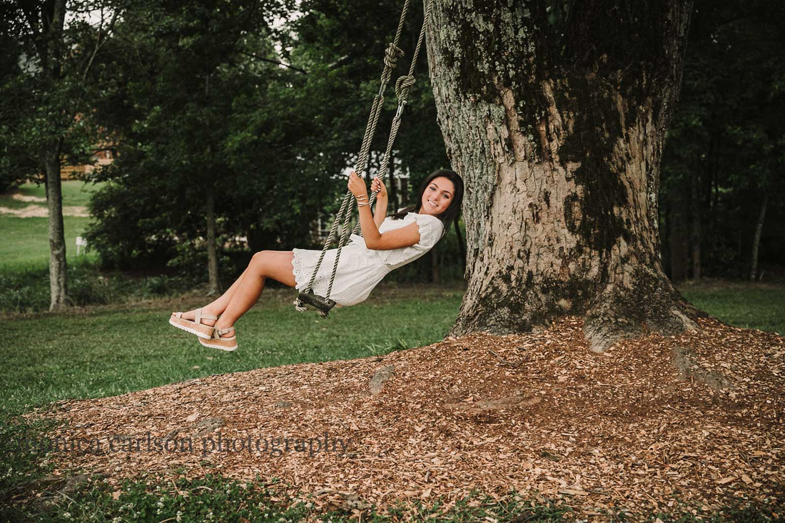 senior girl on a tree swing during a photo session