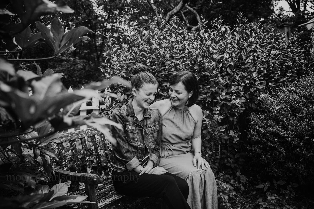 mother and daughter laughing together during a photo session with Monica carlson