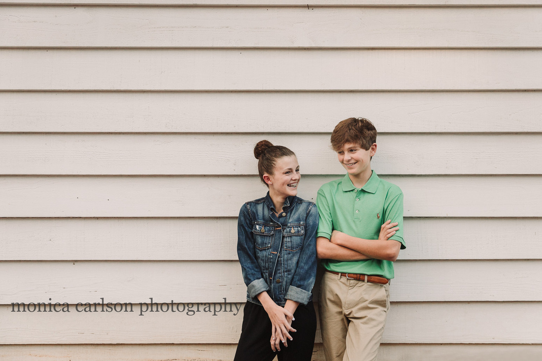 teen siblings laughing together during a photo session
