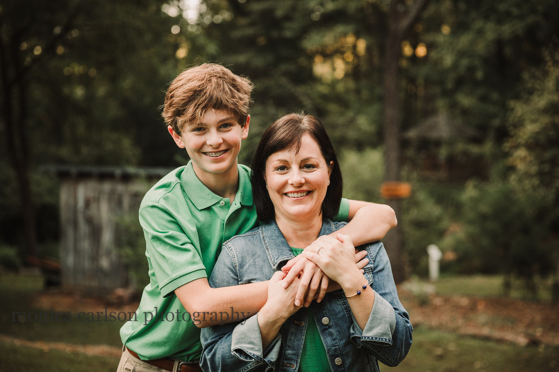 mother and son embrace for a portrait