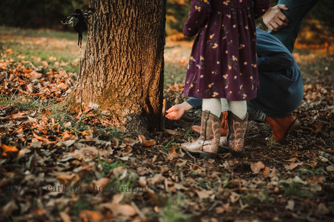 little girls opening a door in fairy garden